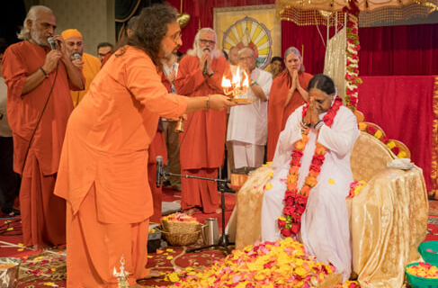 Amma accepts the Arati from her senior disciples during Guru Purnima in Toronto
